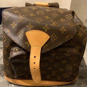 c9d92b224a97 Louis Vuitton. Authentic Louis Vuitton Montsouris GM Backpack.  700  1